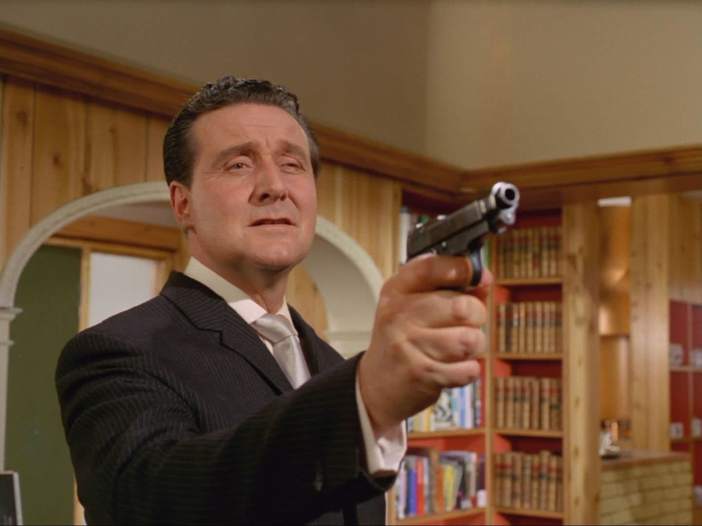 John Steed with a gun
